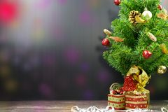 Christmas Tree with Gifts, on black background and fancy bokeh stock photography