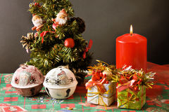 Christmas tree, gifts and candle. A little xmas tree with gifts and candle Royalty Free Stock Photo
