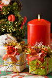 Christmas tree, gifts and candle Stock Photography