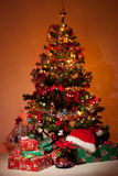 Christmas tree with gifts  and lights Stock Images