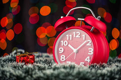 Christmas tree, gifts, lights and alarm clock on abstract backgr Stock Images