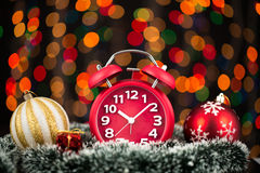 Christmas tree, gifts, lights and alarm clock on abstract backgr Royalty Free Stock Photography