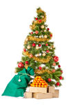 Christmas tree with gifts and mandarines. Christmas tree with gifts and presents bag and mandarines, isolated on white Royalty Free Stock Image