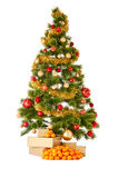 Christmas tree with gifts and mandarines Royalty Free Stock Photos