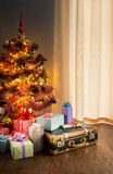 Christmas tree with gifts and old suitcase Stock Photography