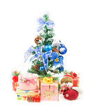 Christmas Tree and Gifts. Over white background stock image