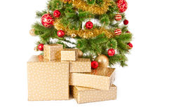 Christmas Tree and Gifts. Over white background Stock Photography