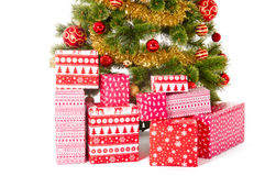 Christmas Tree and Gifts. Over white background Stock Photos
