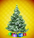 Christmas tree with gifts over yellow Royalty Free Stock Image