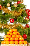 Christmas tree with gifts and presents and mandarines Royalty Free Stock Photo