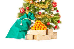 Christmas tree with gifts and presents and mandarines Royalty Free Stock Photography