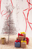 Christmas tree with gifts. Christmas tree with presents on snow and colored fiefs Royalty Free Stock Photos