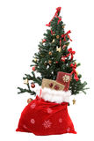 Christmas tree with gifts on sack Stock Photo