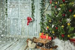 Christmas tree with Sleigh and gifts in room. Christmas tree gifts sleigh christmas tree new year christmas lights Royalty Free Stock Images