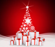 Christmas tree and gifts on snow Stock Image