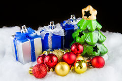 Christmas tree with gifts and sparkle ball. Stock Image