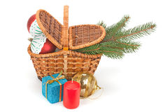 Christmas tree, gifts and toys. Fir branches with balls in the basket, candles and gift boxes isolated on white Royalty Free Stock Photos