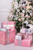 Christmas tree with gifts under it. In a classic bright rich interior Royalty Free Stock Photography