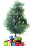 Christmas tree and gifts on a white Stock Images