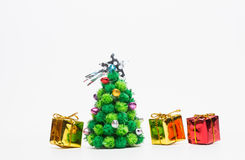 Christmas tree with gifts. On white background Stock Photography