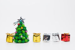 Christmas tree with gifts. On white background Royalty Free Stock Photos