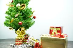 Christmas Tree and Gifts on white background stock image