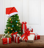 Christmas tree with gifts. On wooden floor Royalty Free Stock Image