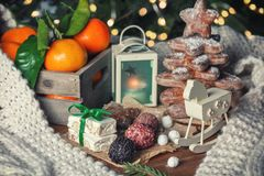 Christmas tree of ginger stars and a box of tangerines. A wooden table Royalty Free Stock Photo