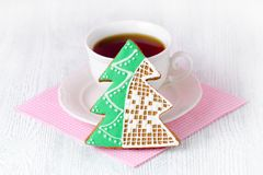 Christmas tree gingerbread with coffe cup on wooden table with pink napkin. Christmas tree gingerbread with coffe cup on wooden table and pink napkin Stock Photos