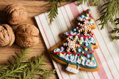 Christmas tree gingerbread cookie. Decorated with royal icing and cookie snowflakes royalty free stock photos