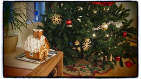 Christmas Tree and Gingerbread House Stock Image