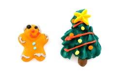 Christmas-tree and gingerbread man Stock Image
