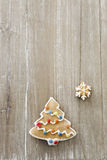 Christmas tree gingerbread. On wood Royalty Free Stock Image