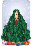 Christmas Tree Girl. Beautiful girl with long green hair shaped like a christmas tree with decorations and presents, a blue sky background and the wind blowing Stock Photo