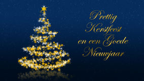 Christmas tree with glittering stars on blue background, dutch seasons greetings Stock Images