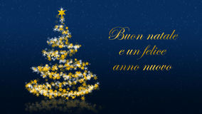 Christmas tree with glittering stars on blue background, italian seasons greetings Stock Photos