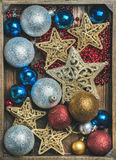 Christmas tree glittering toy stars, colorful balls and garland Royalty Free Stock Images