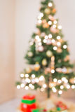 Christmas tree. A Christmas tree with glowing lights in the background Stock Photography