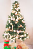 Christmas tree. A Christmas tree with glowing lights in the background Royalty Free Stock Photo