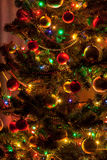 Christmas tree with glowing lights and decorative balls Royalty Free Stock Images
