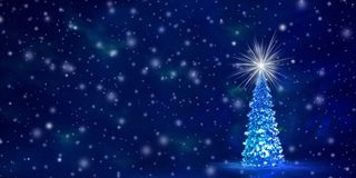 Christmas and New Year`s background with free space for text. Christmas tree with glowing lights on a garland and a shining star on the crown on a blue Northern royalty free stock image