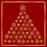 CHRISTMAS TREE IN gold. Gold Christmas Tree isolated on a red background Stock Photo