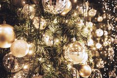 Christmas tree with gold ball and bokeh lights background. Xmas royalty free stock image
