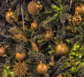 Christmas tree with gold balls. And snowflakes Royalty Free Stock Photos
