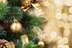 Christmas tree with gold blurred light background stock photo