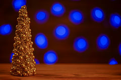 Christmas tree gold candle with blur background Stock Photo