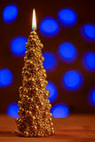 Christmas tree gold candle with blur background Royalty Free Stock Image