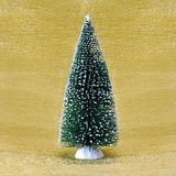Christmas tree on golden background Stock Images