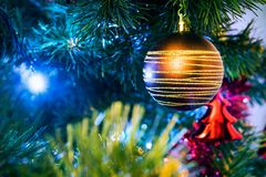 Christmas tree and golden bauble Royalty Free Stock Photo