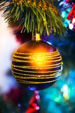 Christmas tree with golden bauble Royalty Free Stock Photos